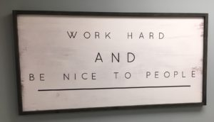 Whiteboard on Wall says Work Hard and be nice to people